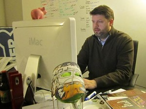 The City Paper Editor Steve Cavendish edits a story at his desk Oct. 30, 2012. (Photo by Lee Roberts)
