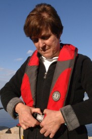 Carolyn Bauer, who led the water safety program for the U.S. Army Corps of Engineers Nashville District the past 16 years, demonstrates wearing an automatic life vest at J. Percy Priest Lake March 12, 2013.  It inflates with manual movement of T-cord or automatically upon immersion in water and is recommended only for adults who can swim.  Bauer retired from the Corps March 1, 2013 after more than 35 years of federal service. (Photo by Lee Roberts)