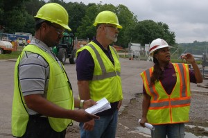 Harold Cunningham (Center), construction teacher, and Victor Bright, history teacher, both from Cane Ridge High School, tour a construction site June 6, 2013 with Debbie Dowell, U.S. Army Corps of Engineers Nashville District project engineer, at the lockmaster's operations center at Cheatham Lake in Ashland City, Tenn. (Photo by Lee Roberts)