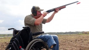 Spc. Casey Wacasey Jr., shoots during the Lone Star Wounded Warriors Skeet Shoot in Castroville, Texas Sept. 28, 2013. (Photo by Lee Roberts)