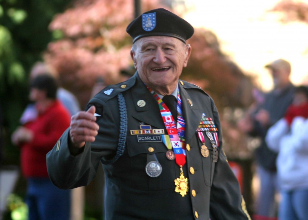This decorated veteran waves to the crowd on Broadway during the Nashville Veteran's Day Parade Nov. 11, 2013. (Photo by Lee Roberts)