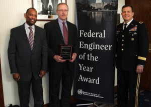 Maj. Gen. John W. Peabody (Right), U.S. Army Corps of Engineers deputy commanding general for Civil and Emergency Operations, and James C. Dalton (Left), USACE chief of Engineering and Construction, pose with Mike Zoccola, chief of the Nashville District Civil Design Branch, during the Federal Engineer of the Year Banquet Feb. 20, 2014 at the National Press Club in Washington D.C. Zoccola, the 2013 Corps of Engineers Engineer of the Year, was honored as one of 10 finalists for the FEYA by the National Society of Professional Engineers. (Photo by F.T. Eyre)