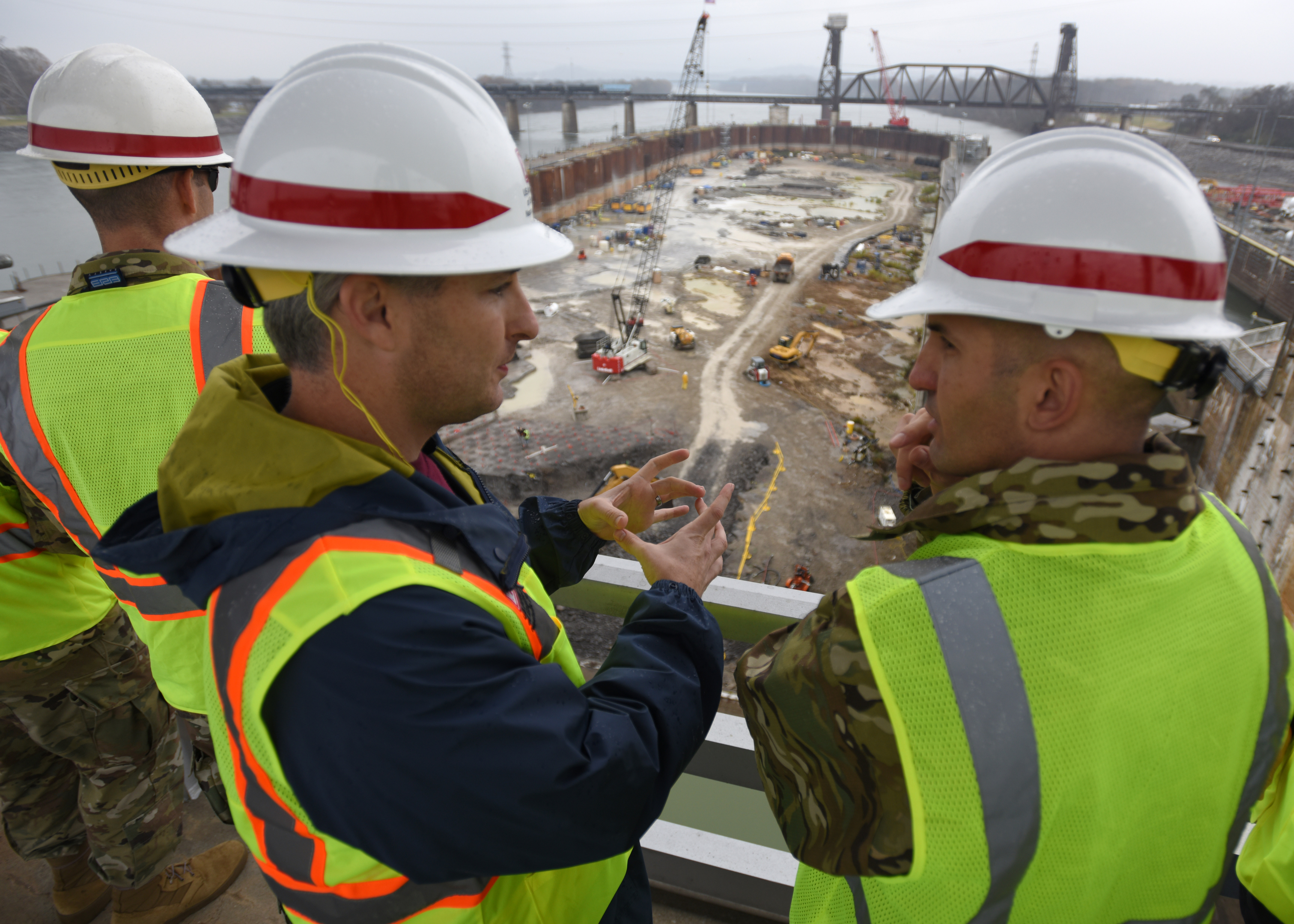Col. Paul Kremer (Right), U.S. Army Corps of Engineers Great Lakes and Ohio River Division acting commander, gets an update on the Chickamauga Lock Replacement Project from Adam Walker, project manager with the Nashville District, during a visit Dec. 5, 2017 to the construction site at Tennessee River mile 471 in Chattanooga, Tenn. (USACE photo by Lee Roberts)