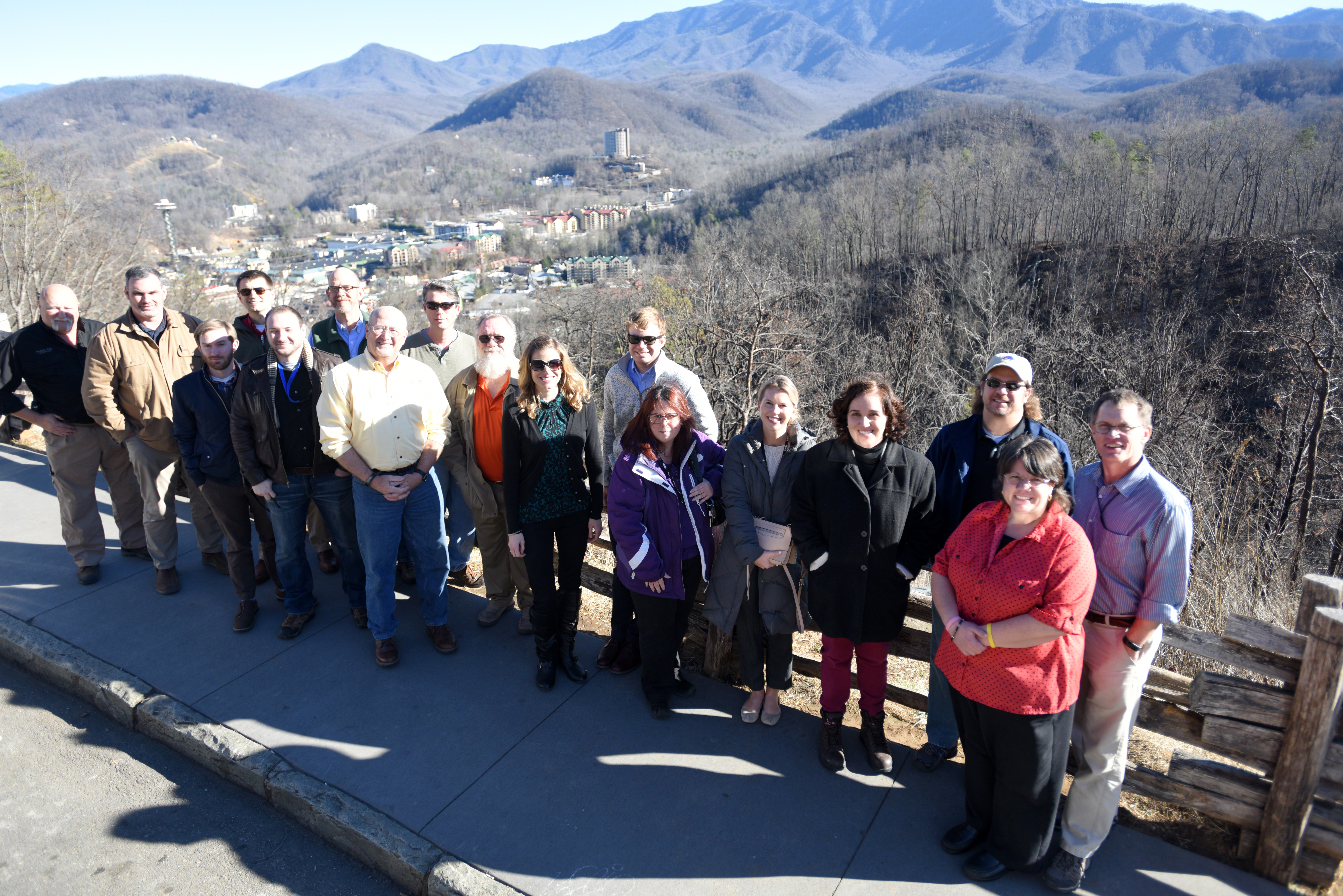 Members of Tennessee Silver Jackets pose at the Gatlinburg Bypass Overlook overlooking Gatlinburg, Tenn., Jan. 25, 2018. The team toured the area and received a briefing on the wildfires that moved through Sevier County and city of Gatlinburg in November 2016. (Photo by Lee Roberts)